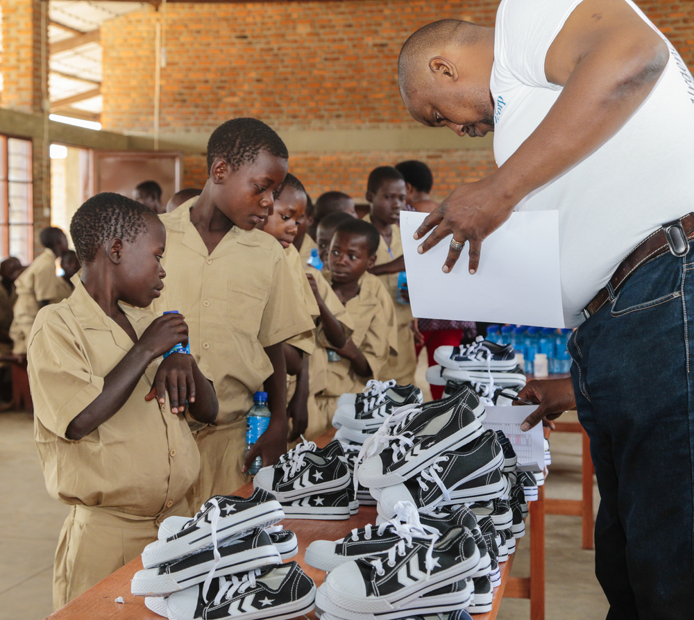 Students receiving their fitted pair of shoes.