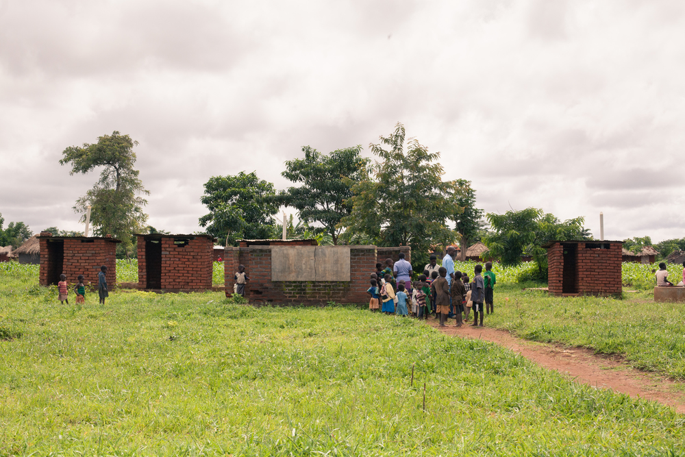 Students line up at the latrines to deliver stool samples.
