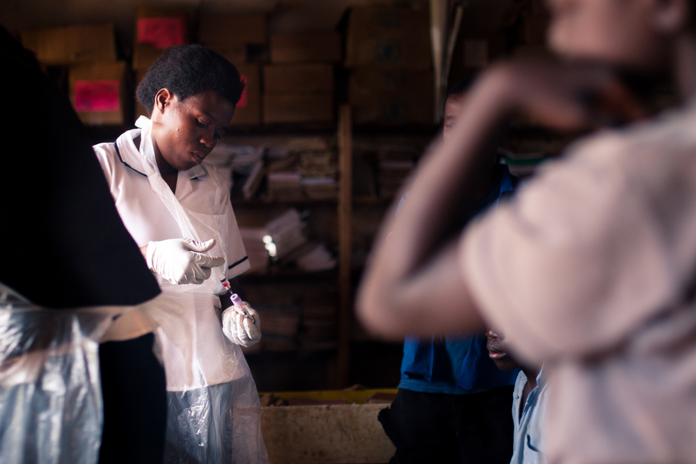 Hawa prepares a blood sample to be taken back to the lab.