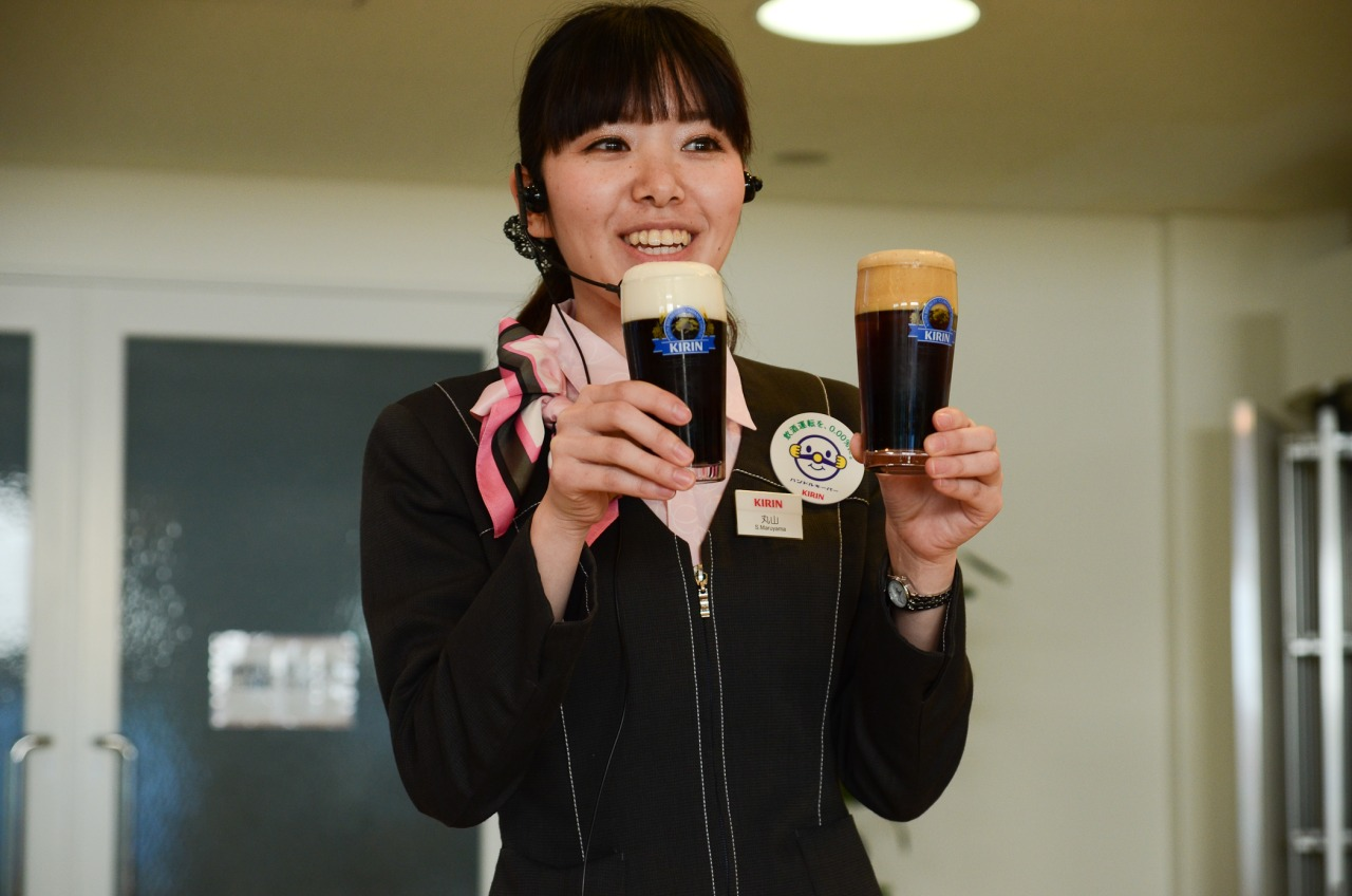 Our lovely guide showing us how to properly pour a beer to the Kirin standard.