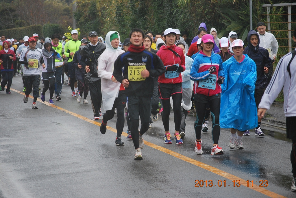 So far the only photoraph I could find of us, from the Marathon's website.  If you look behind the girl with the pink hat toward the right, there is Samantha. To her left is a purple hooded figure, that is blocked, most likely with an exhausted cold look.