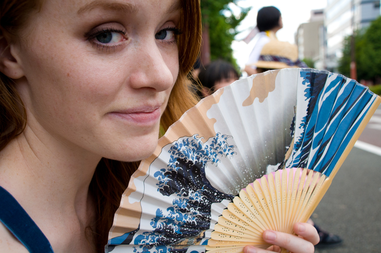 Fanning ourselves off in the summer heat while watching the Kurume Festival Parade