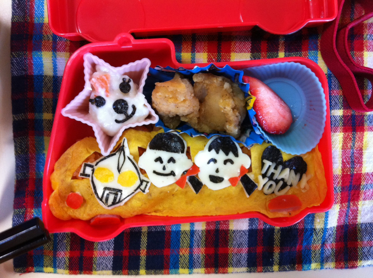 More amazing bento photos. This is me and my partner teacher on anomelette. I think I am the one on the right. The character on the left is Ultra-man. He is one of the most popular characters among Japanese 5 year olds.
