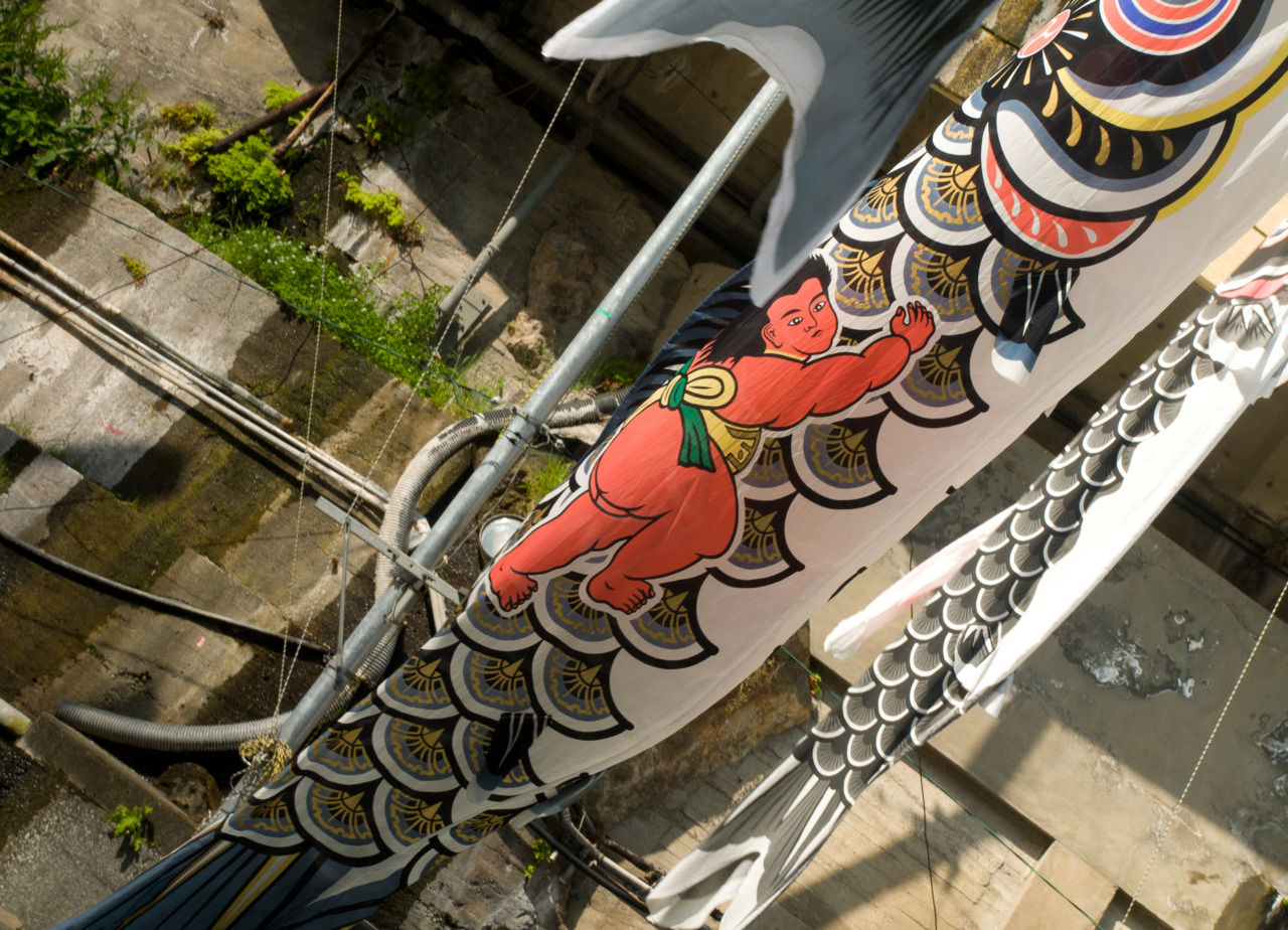 Printed on the side of this Koinobori is an exemplary figure of the type of boys you will raise if you hang this outside of your home.