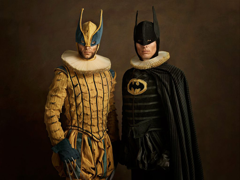 The Flemish Wolverine and batman pose for a photo mean mugging
