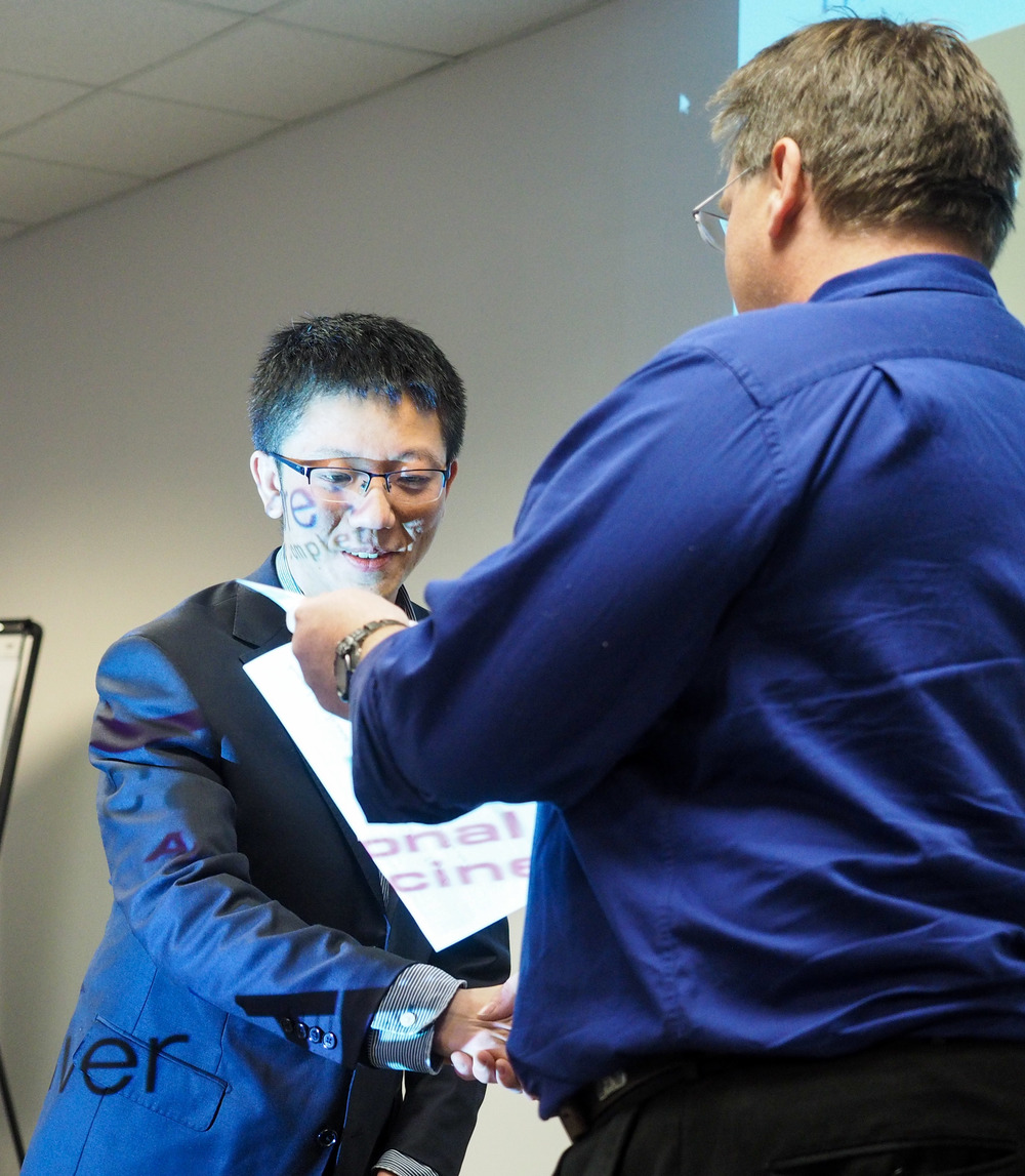 RTP DMDG Poster Review Chair, Steve Ferguson, presents Hao Cai with the poster award.