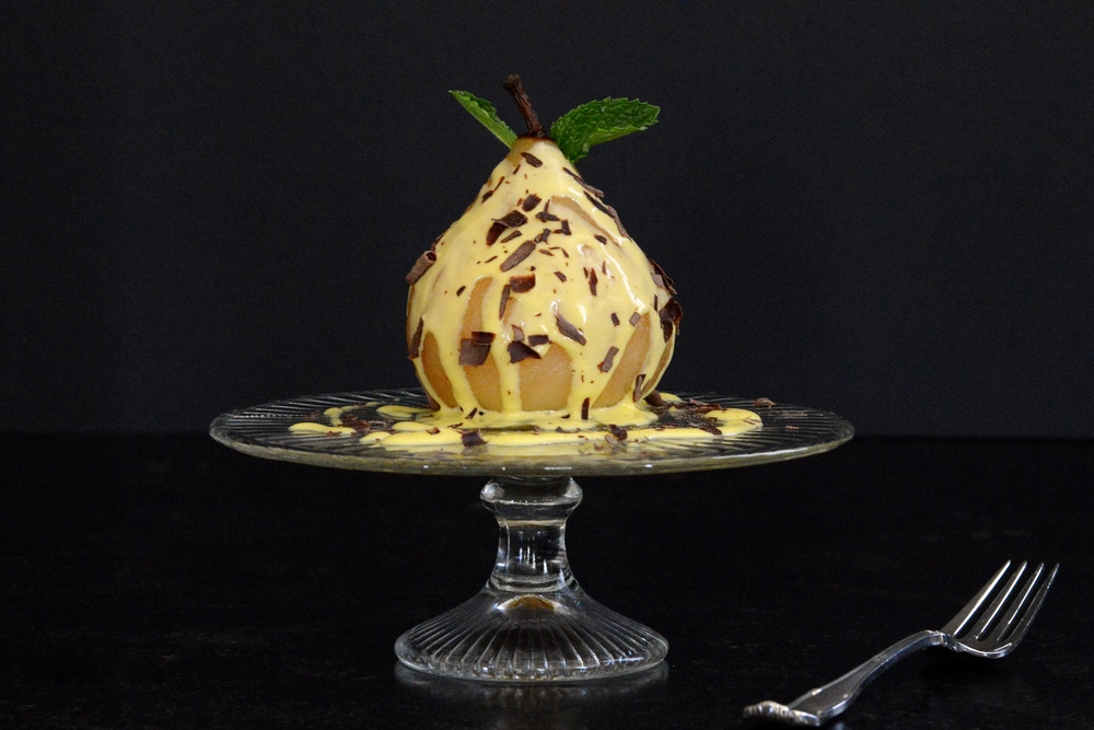 Poached Bosc Pears with Honey Crème Anglais & Bitter Chocolate Shavings