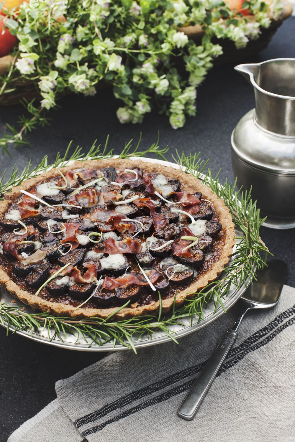 FIG, GORGONZOLA & PROSCIUTTO TART - One of earth's healthiest and most luscious foods, a fig's chewy flesh, smooth skin and crunchy seeds make a dramatic presentation in any dish. Combined with the crumbly texture and green-blue marbling of Gorgonzola and the salty, meaty flavor of Italian prosciutto, this decadent savory tart deserves to be served with a lightly dressed salad and a glass or two of Proseco.