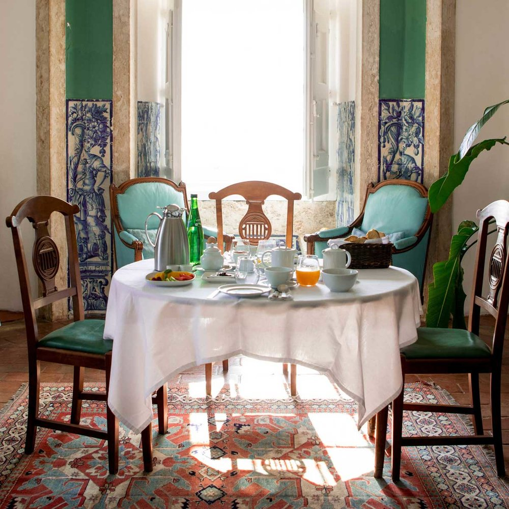 Palacio Belmonte - Lisbon, PortugalOriginally built in 1449, three defense towers rise from ancient fortified Roman and Moorish walls and provide a bird's-eye-view of Alfama and the river Tejo. One of the most beautiful and romantic hotels in the world, visionary Frédéric Coustols restored the palace to its former glory, transforming ruins into an architecturally and culturally sound tribute to Portugal's rich history.A heavy red wood door is the only indicator that you have arrived at the palace. As it swings open, time travel seems almost possible. Quietness resonates and only the footsteps of the front desk attendant may be heard echoing on the stone floors as he patters to greet guests. Take a look around at the simple furnishings. Every detail is carefully selected to tell a story. The ego mirror hanging to the left of the entrance is the visitor's first glimpse into Coustol's genius. Stare into the glass and notice your image is not present. Rather, you are invited to see a world without the weight of personal self-importance--the reflection is of the beauty around you. This perspective is the key to relishing the beauty and the imperfections of thousands of years of history preserved within the palace's walls.