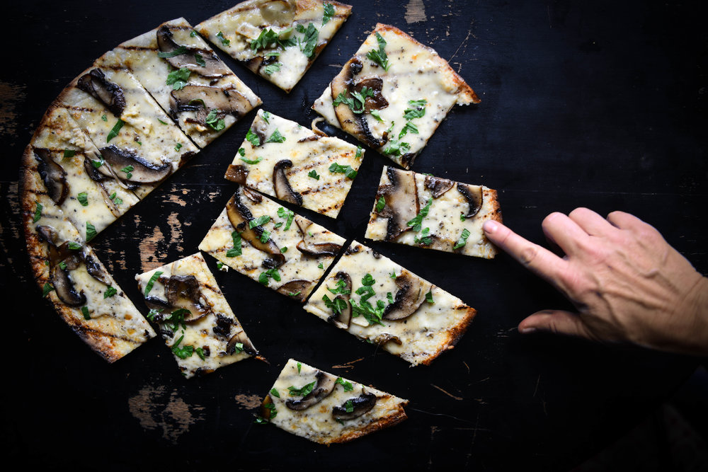 - The inspiration for this pizza pie came from a menu special served at Tom Douglas' SERIOUS PIES in Seattle. He makes his own blistering crust in a stone encased applewood fired oven. For the home cook, this version is divine.
