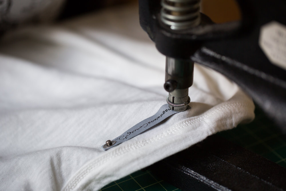Each t-shirt is tagged by hand in our studio, because details make the shirt.