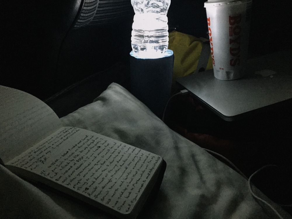Journal + makeshift lamp.