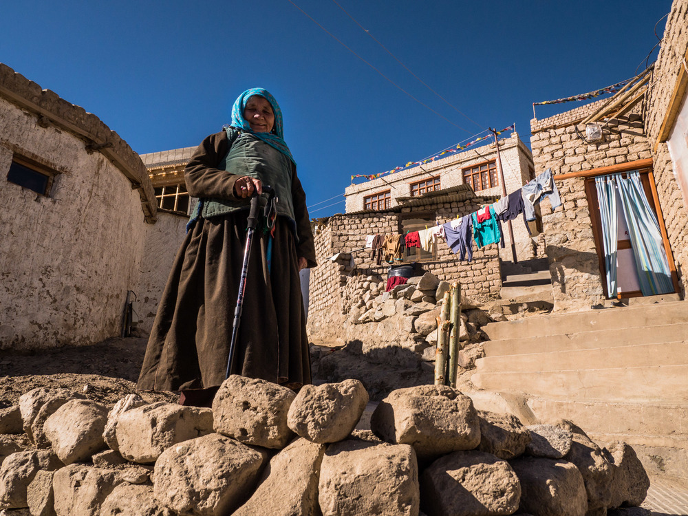 _15 Elderly woman infront of her house washing lines Leh India.jpg