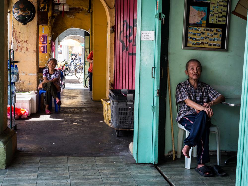 _38 Elder man and woman sitting Penang Malaysia.jpg