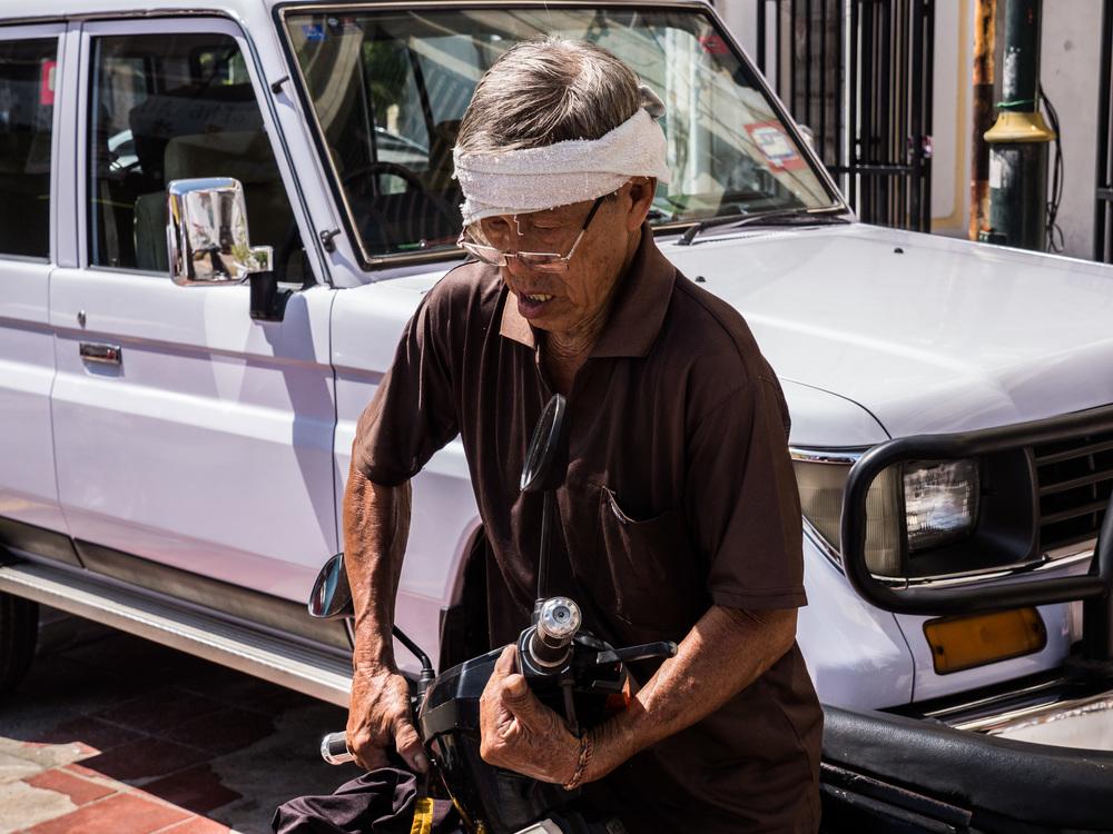 _39 Older man moving Bike Penang Malaysia.jpg
