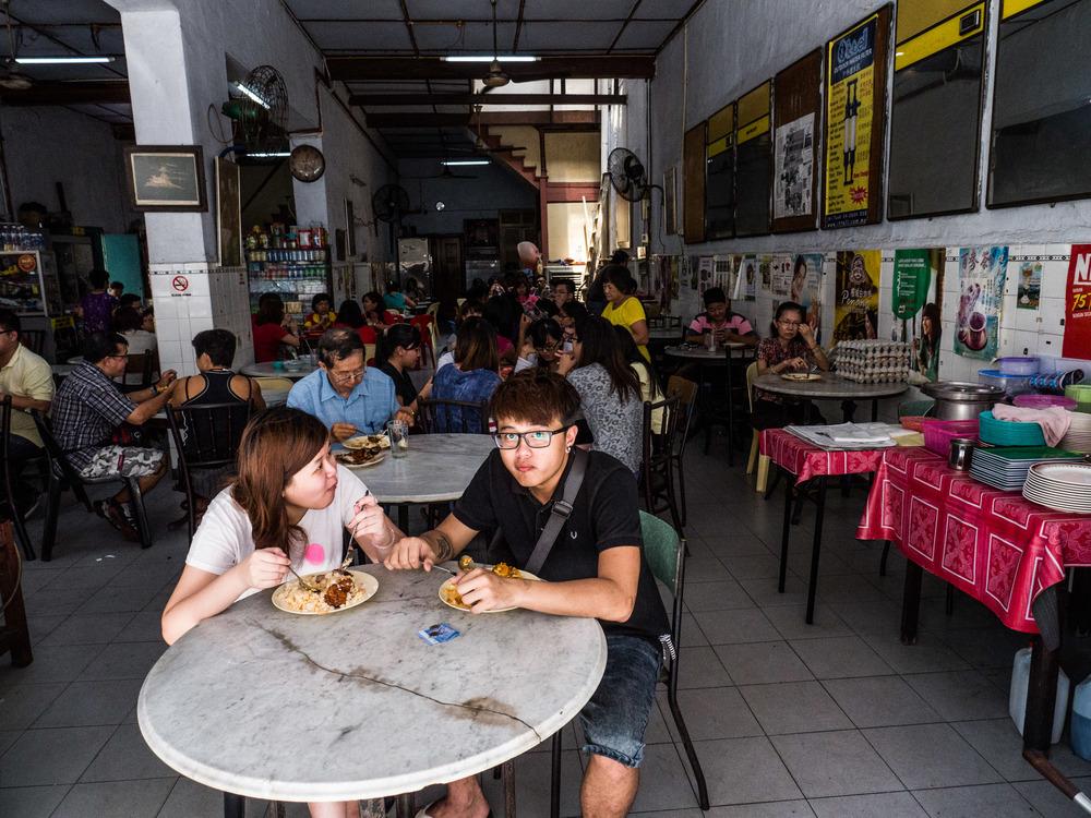 _41 People eating food in Restaurant penang malaysia.jpg