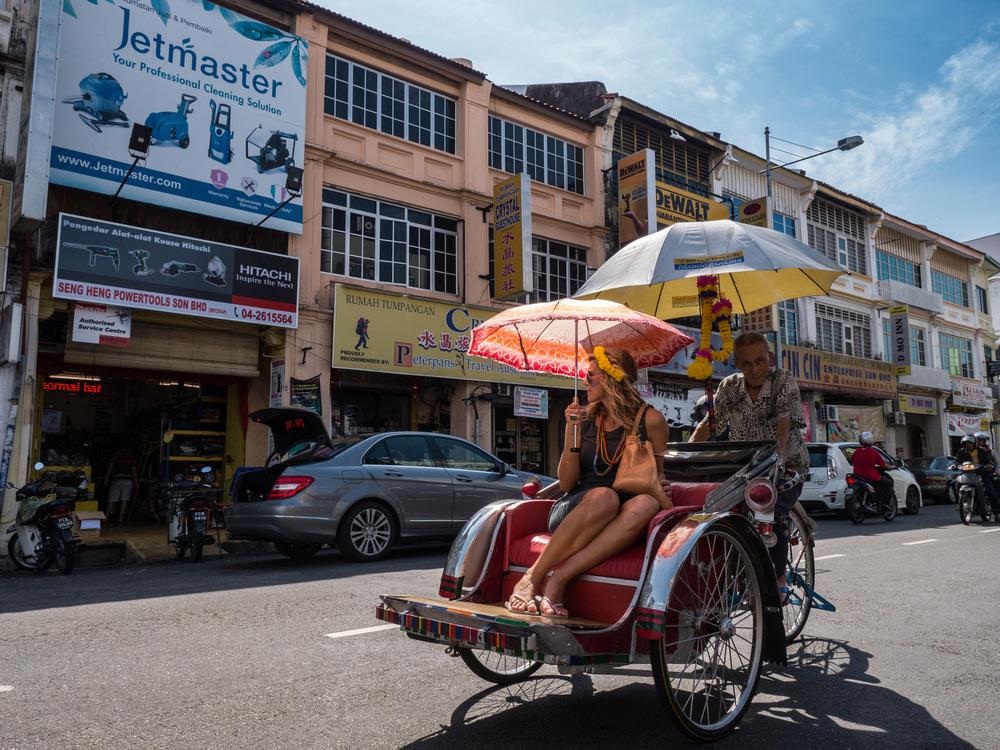 _42 Becak driver taking blonde woman penang malaysia.jpg