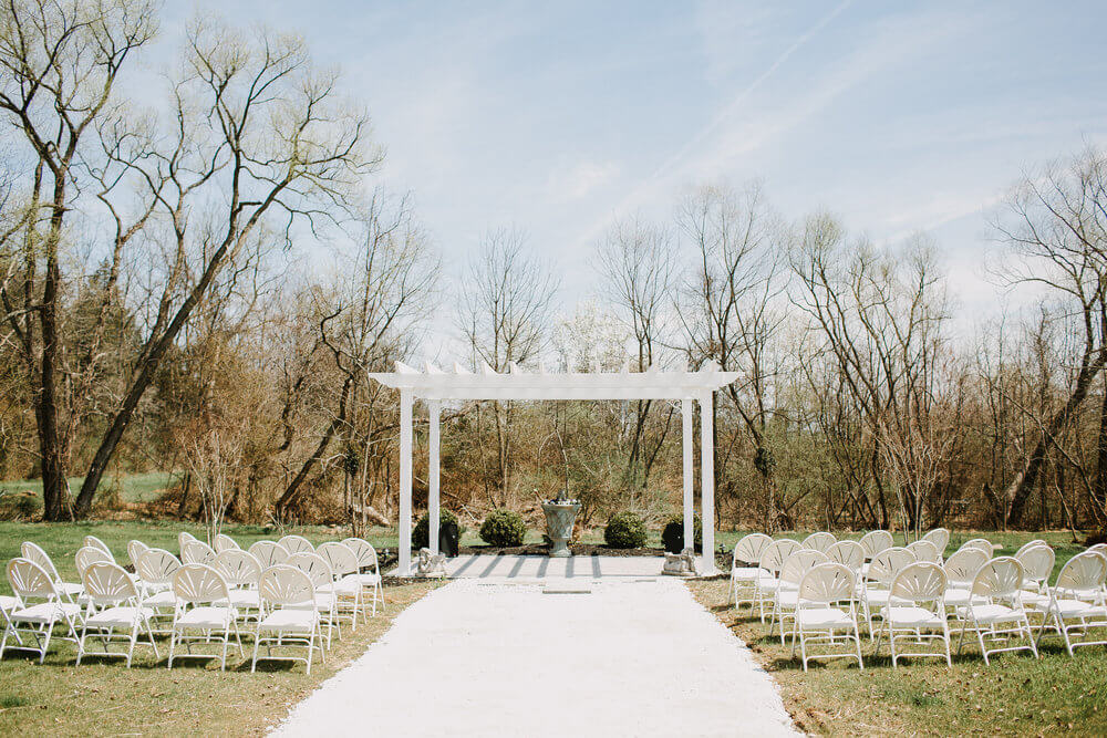 Copy of The wedding garden pergola set up with chairs for a wedding.