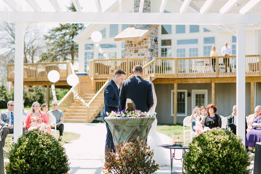 Copy of A wedding in the wedding garden with pergola framing the happy couple