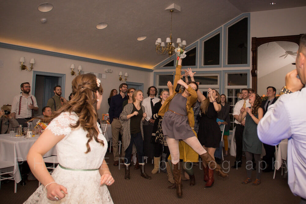 Copy of guests on the dance floor inside the solarium wedding and event venue