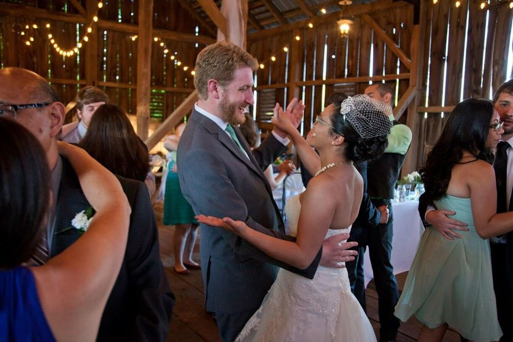 The Bride and Groom dancing during a reception held inside the Historic Barn Wedding & Event Venue Battlefield Bed and Breakfast Inn, Gettysburg, PA
