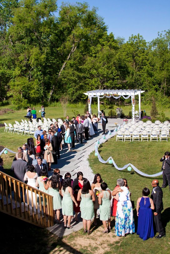 A wedding ceremony in the outdoor wedding garden at Battlefield Bed and Breakfast Inn, Gettysburg, PA