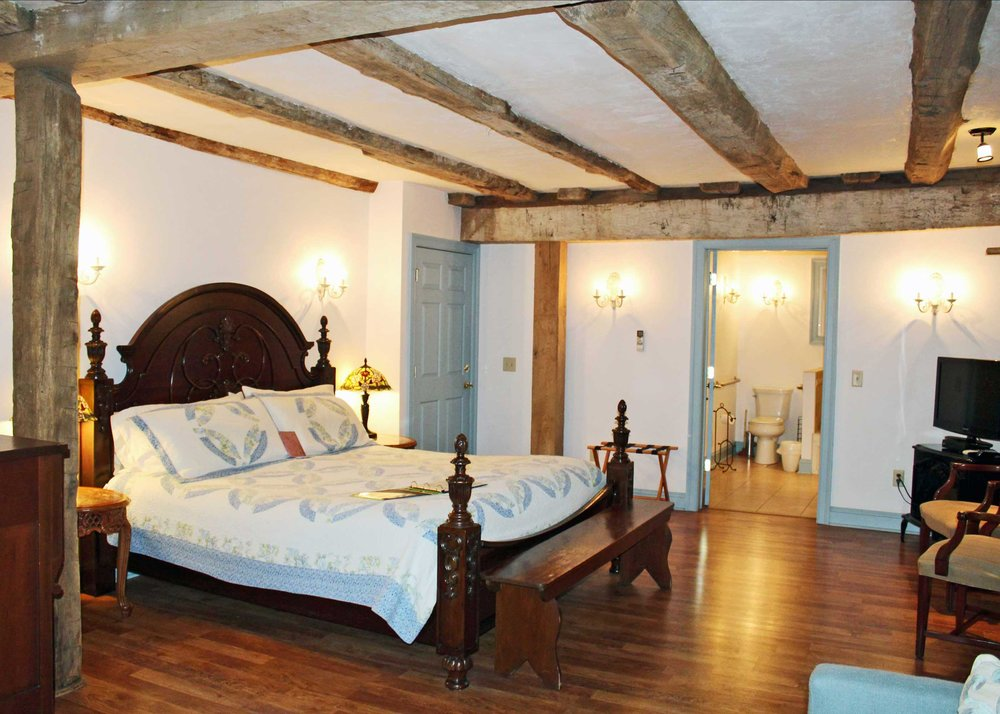 In a Romantic Room - We offer beautiful historic rooms with romantic details such as: extra large rain showers, double soaking tubs, jacuzzis, King size beds, and private entrances.