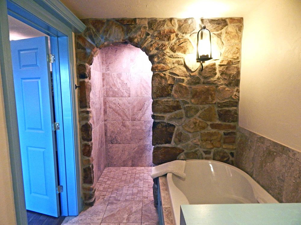 Features Designed for Romance - We have rooms with extra large rain showers, double soaking tubs, Jacuzzis, and unique romantic features such as a stone facade in the Houghtelin's Hideaway bathroom (pictured above).