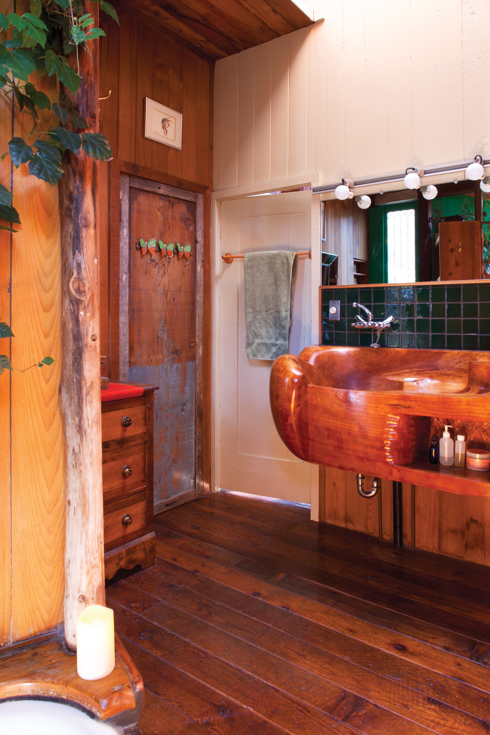 In the second-floor bath, more architectural salvage and a carved wood sink by sculptor J.B. Blunk remind of the house's history as an icon of first-generation environmental architecture.