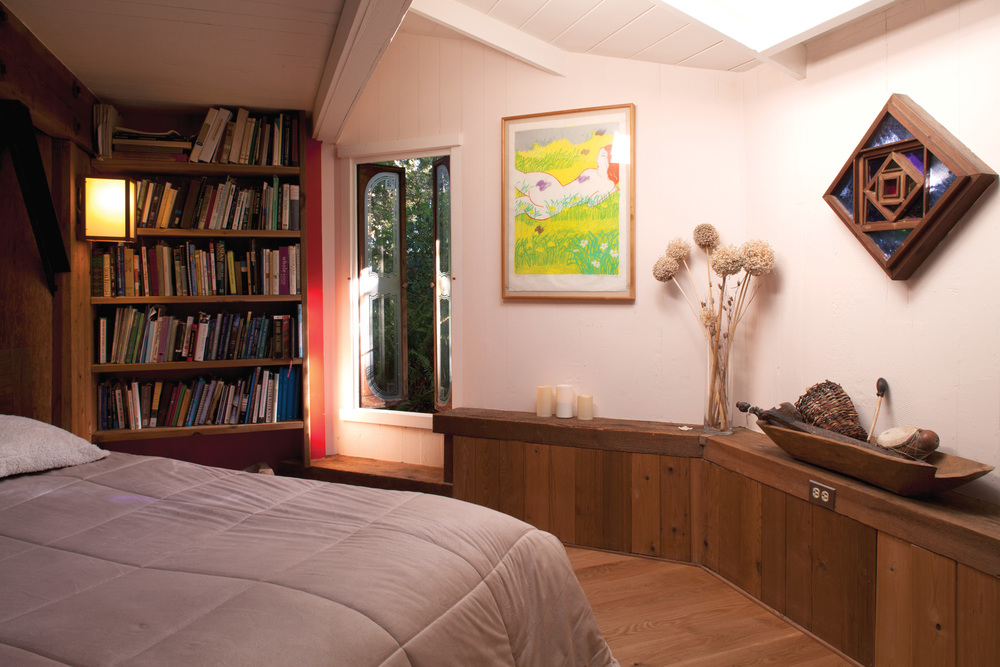 One of three first-floor bedrooms has a portion of the Van der Ryn Architecture and ecology library.