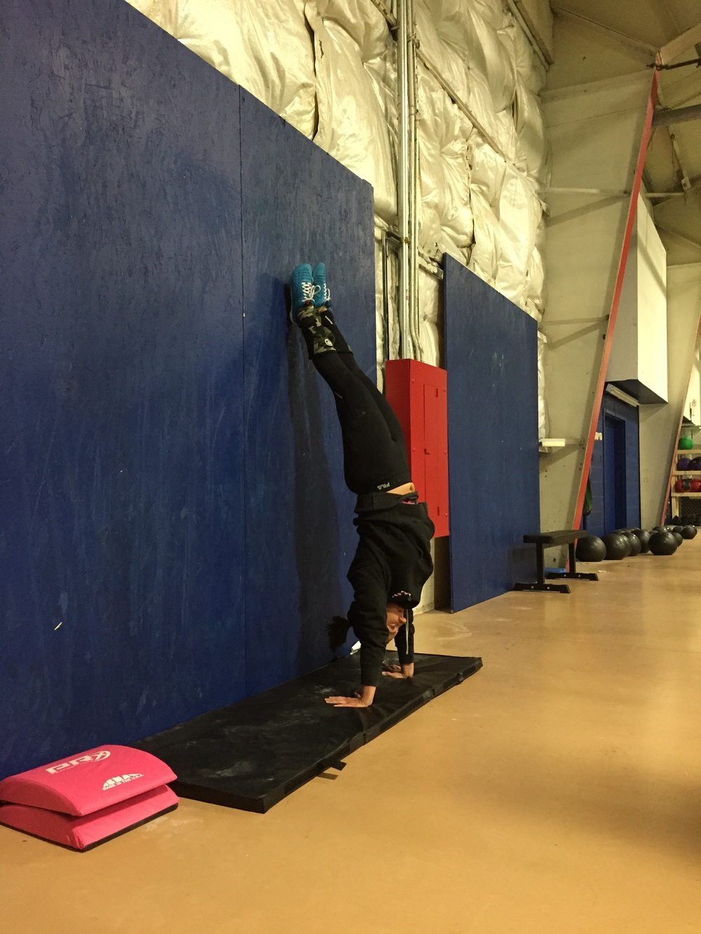 Kristen working on her handstand position.