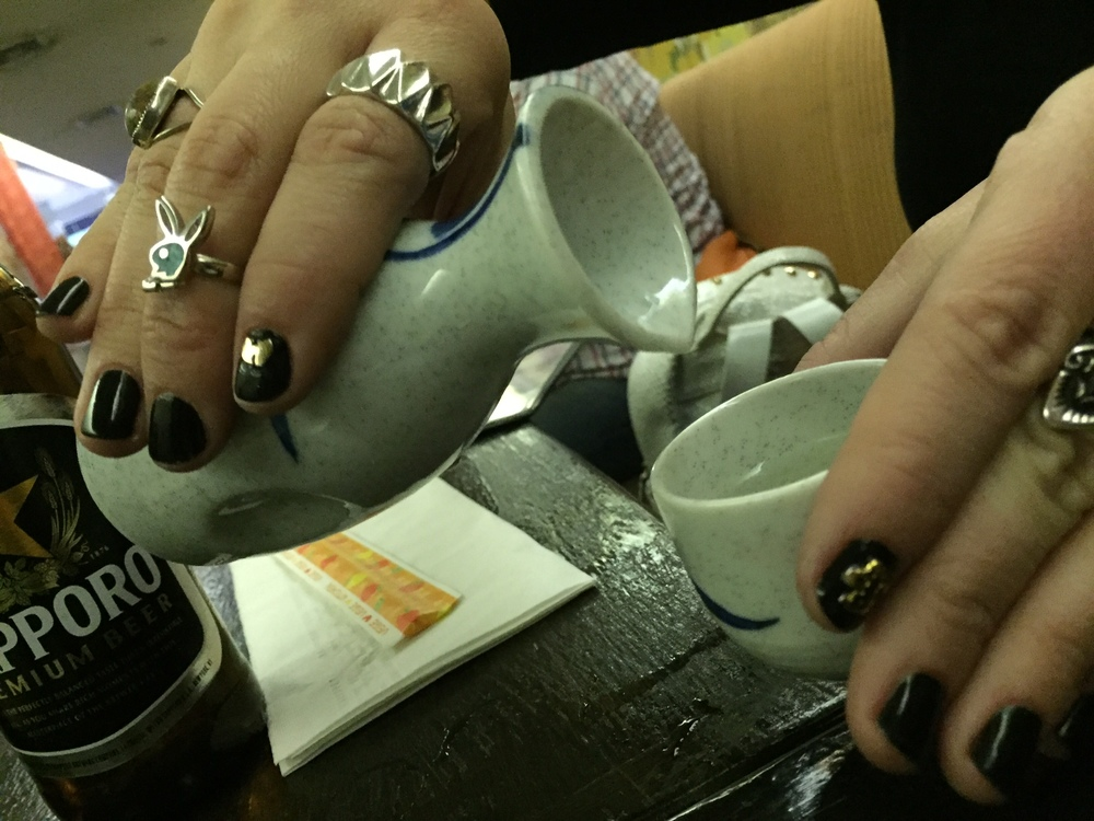 Pour Sake while your mani slays