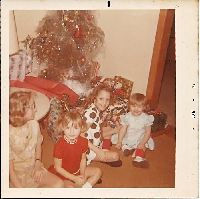 My cousins, Terri, Rhonda, Debbie and Me (2yr old)  Notice the saddest, ugliest Christmas tree in the history of EVER!  It looks like it has cobwebs all over it!