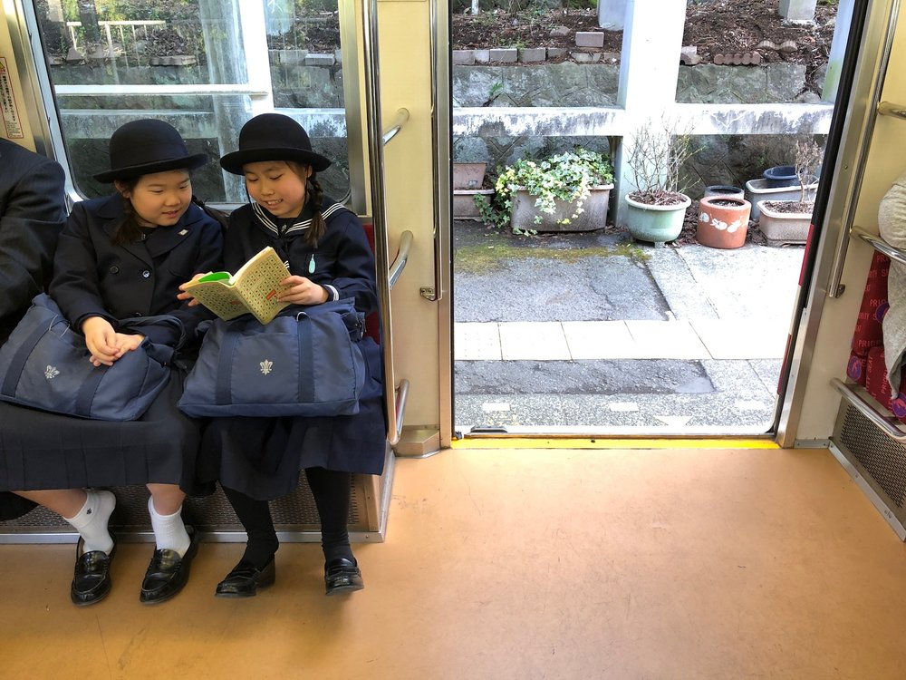 A pair of schoolgirls on their afternoon commute on the Hakone Tozan Line, a very old (and slow) railway line with tons of switchbacks that carries locals and tourists alike throughout Hakone.