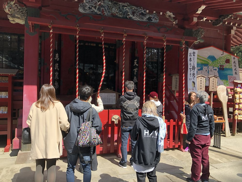 People lined up to ring the suzu bell at the Hakone Shrine before praying. The bell is meant to awaken the gods to hear your prayers.