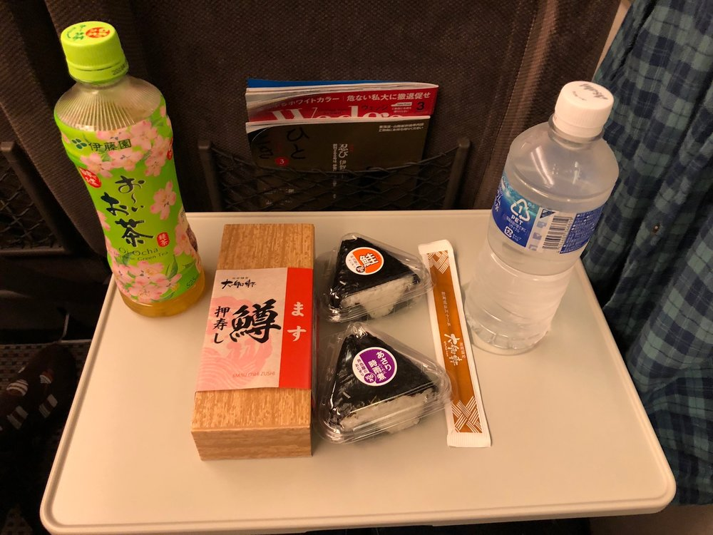 Our shinkansen snack--salmon nigiri and mystery omusubi. These handroll-type snacks never had english text, so we never knew what would be tucked inside the seaweed and rice.