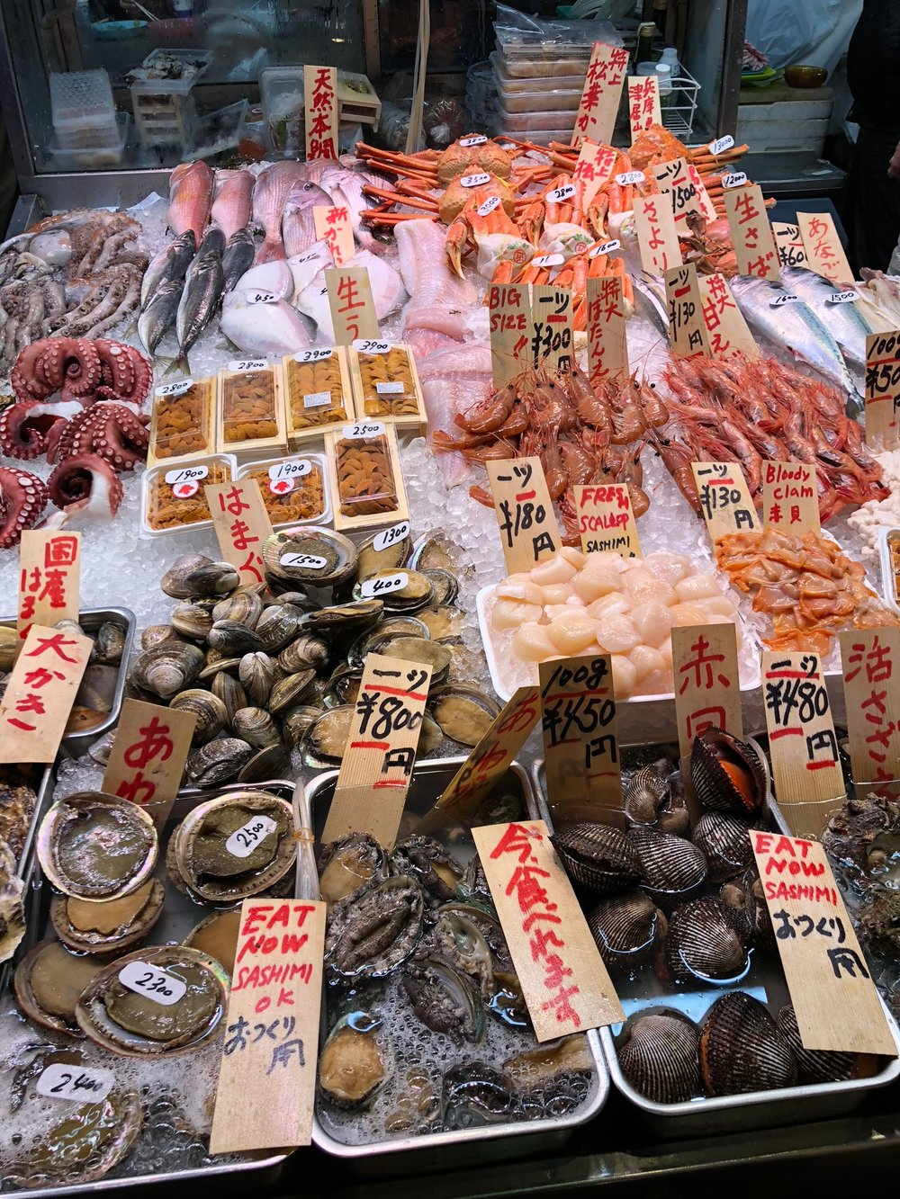 Seafood galore. Some stalls were serving up fresh & raw seafood to be eaten on the spot -- they'd open up oysters for you to knock back, discard the shells, and continue your market stroll.