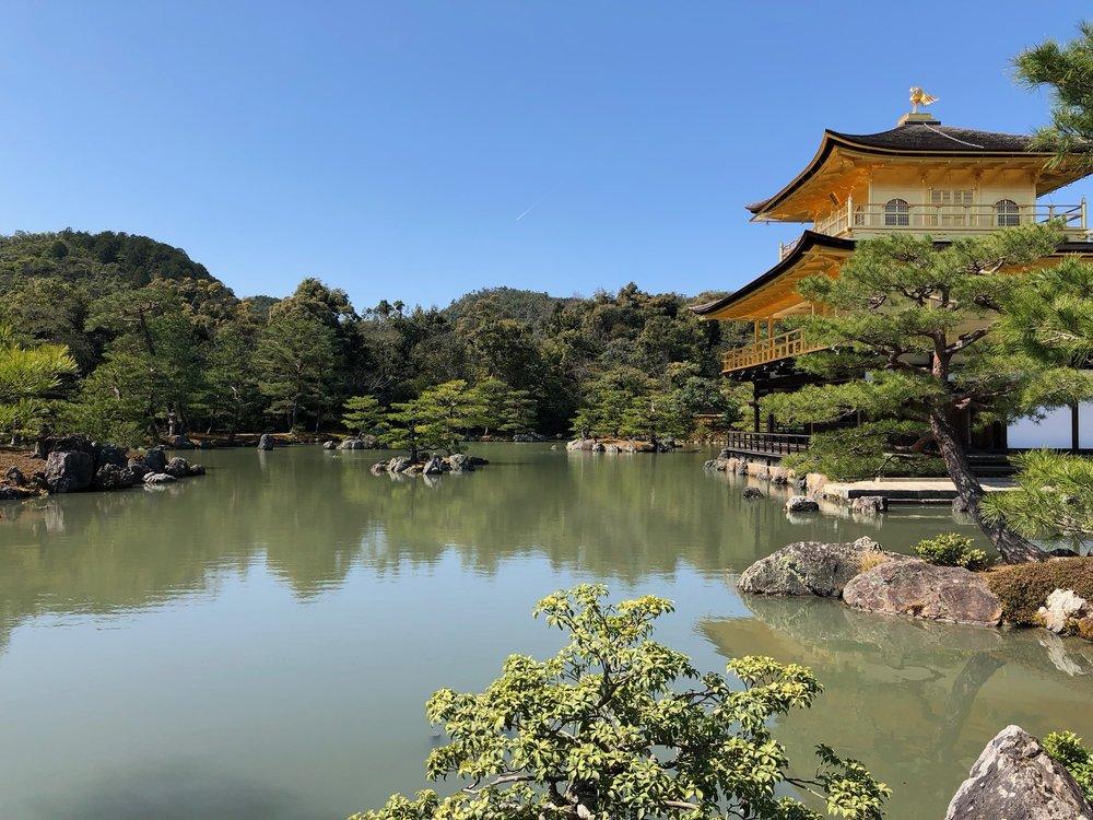 Wider shot of Kinkaku-ji showing off the wonderful pond and surrounding grounds that enhance its beauty.