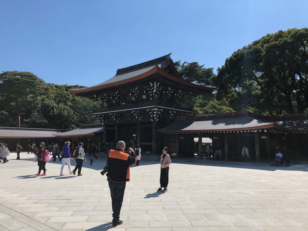 Opposite the building in the plaza at the Meji Shrine