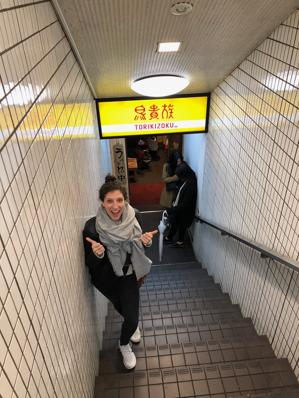 The same night we drank in some Golden Gai bars we had to figure out where to eat for our last night in Japan. I was in the mood for yakitori again so after a few missteps finding one, we landed on one underground. Alix poses on the steps down into the joint.
