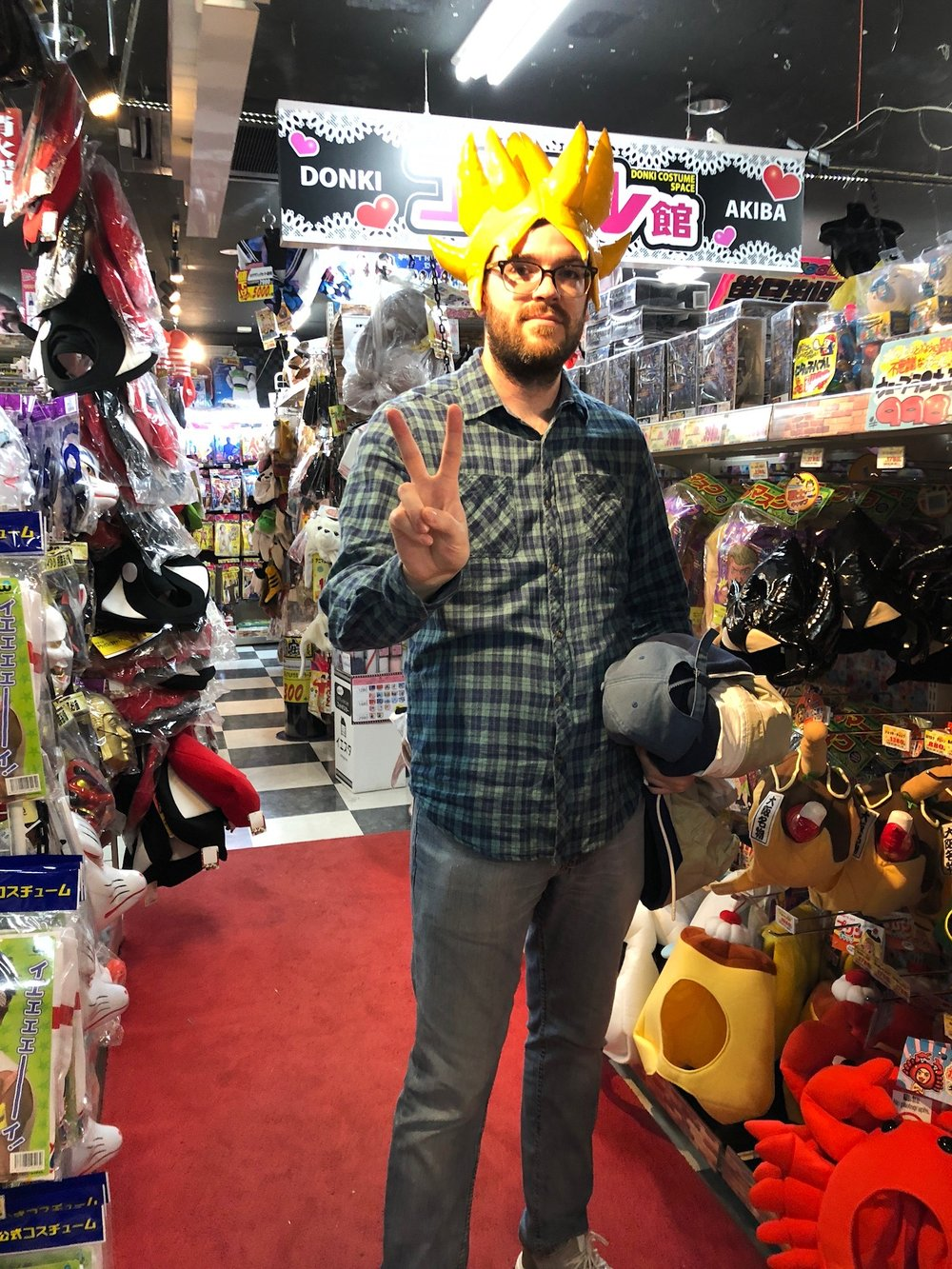 Steve poses wearing a Dragonball-Z themed hat in Don Quijote.