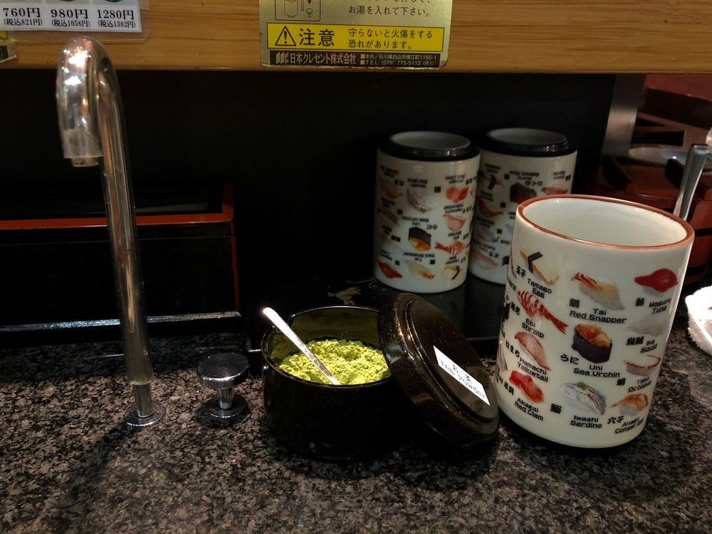 After Senso-ji we stopped at a nearby conveyor belt sushi shop. Every few seats there was a hot water faucet and a small bowl of powdered green tea.