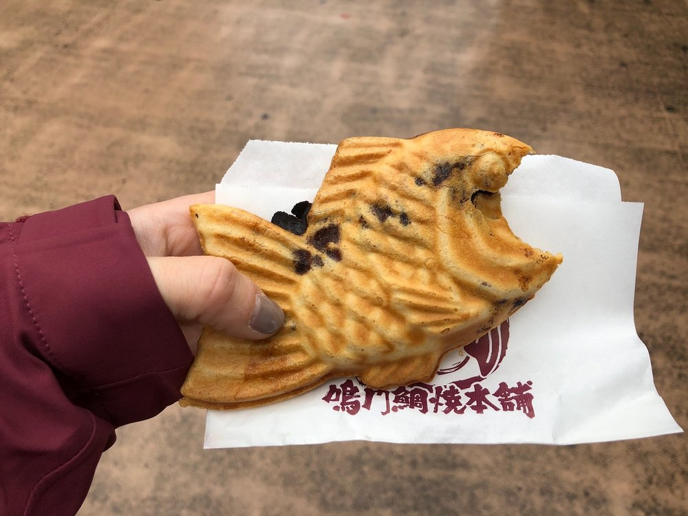 Alix was on the hunt to find one of these waffle textured fish-shaped treats made fresh and hot in a number of places throughout the city. The inside was filled with a sweet bean paste... it looked more tasty than it actually was.