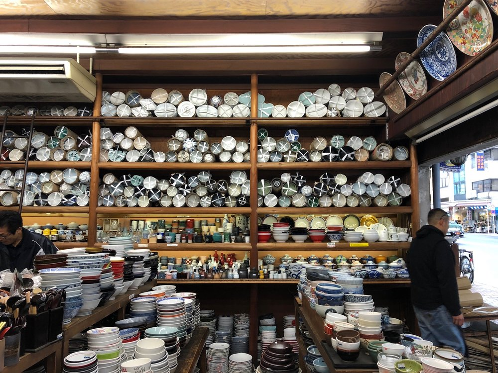 "One of our goals was to do some shopping at ""Kappabashi Street"" - known as ""kitchen town"" in Tokyo. Every single shop on a 6 block section of a particular street is a cookware or knife shop. We found an amazing glassware/bowl shop with a very warm and friendly owner. She made a point to ask us where we were from and we found out she had lived in Santa Monica for many years - she was overjoyed to talk to us about it and made sure to remind us that we HAVE to come back and visit the shop when we come back to Japan in the future. We found some great bowls for our ramen eating stateside!"