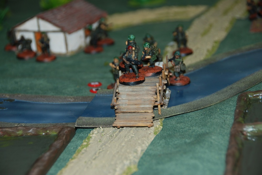 Baker team cautiously crossing a bridge