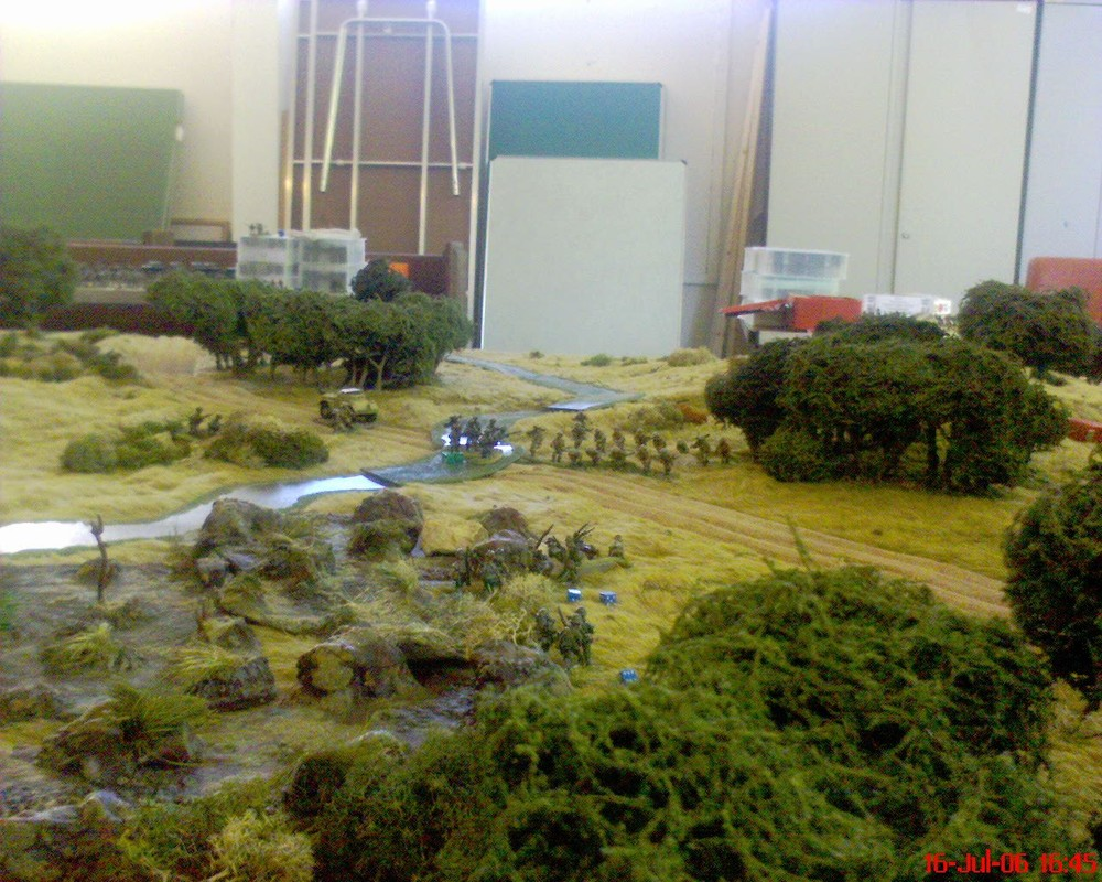The gallant end of the Japanese HQ (nearest the Aussies naturally) and 2nd platoon (who started in the woods in the foreground), and rapidly learnt that moving in the open made them a target for Vickers guns directed by an eagle eyed Colonel Assheton. He actually got 28 on 5 d6: ouch! For those who know the scenario, the Daimler Dingo is doing proxy for the DR.