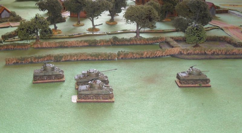 Sherman platoon switches axis of attack
