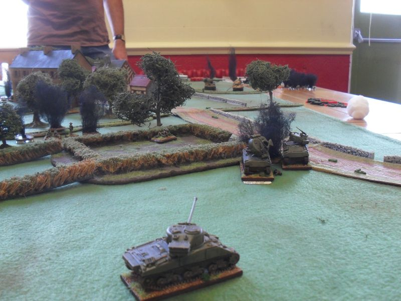 Two Shermans versus a Tiger and a Panther, what could possibly happen?