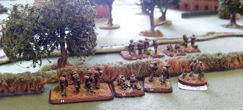 Canadian infantry cross the hedge line and start to advance