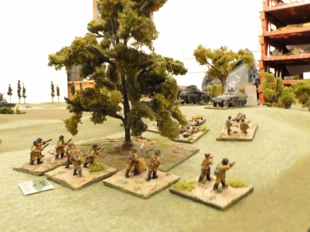 Russian infantry reach the edge of the wood as the Germans top the hill.